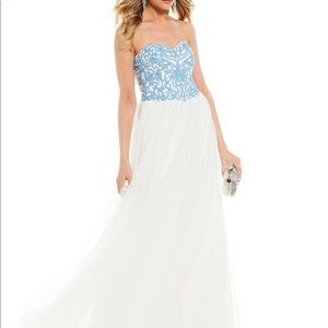 White and blue strapless prom gown